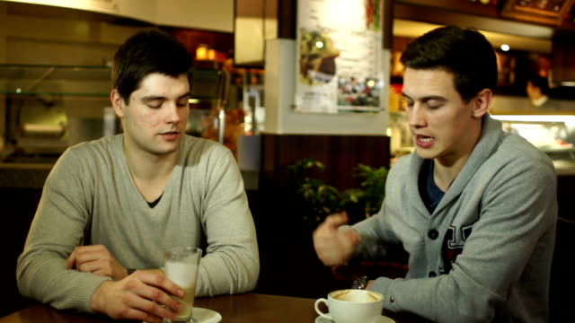 Two guys meeting up in a coffee shop video