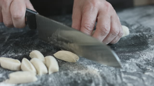 Two hands making dough for meat dumplings. video