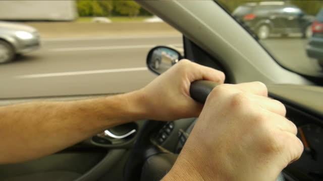 Two hands on steering wheel video