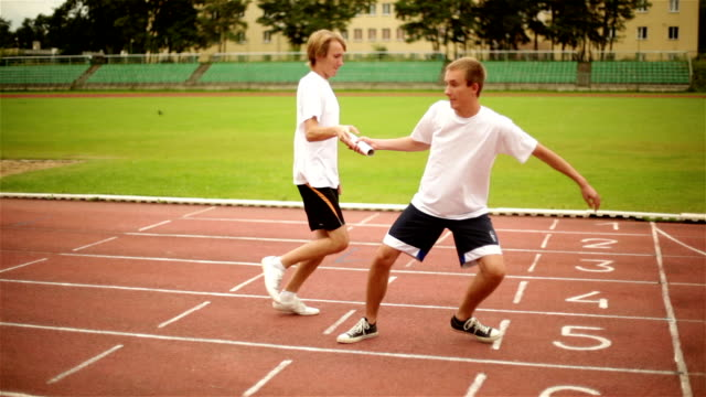 Two Hands Passing Relay Baton video