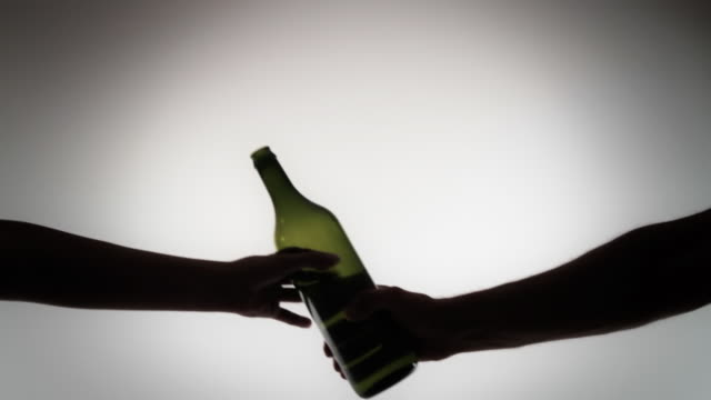 HD: Two Hands Pulling For Bottle video