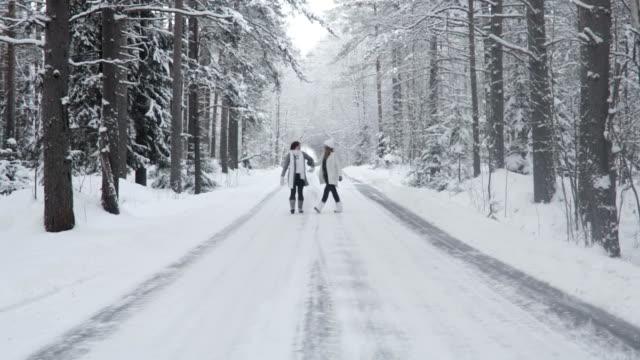 Two Happy Women Walking In Winter Forest video