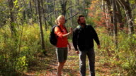 Two hikers stop to look at something in the woods video