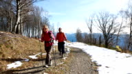 Two hikers walking on mountain trail video