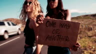 Two Hipster Girls Hitchhiking Together video