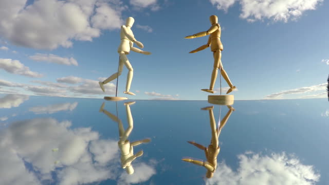 Two human artist models on mirror, time lapse video