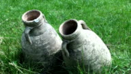 Two italian high ancient clay jug on the grass video