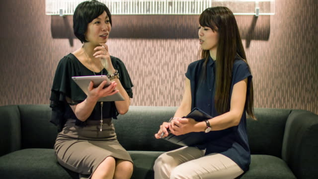 Two Japanese businesswomen on a meeting video