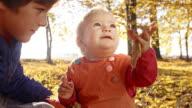 Two kids enjoying the autumn video