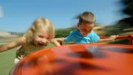 HD: Two Kids Having Fun On Playground Wheel video