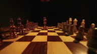 Two kings being brought and put in the center of a chess board, isolated on a black background video