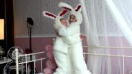 Two little girl in rabbit hare costume in photo studio video