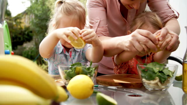 Two Little Girls Cutting Fruits for Smoothie video