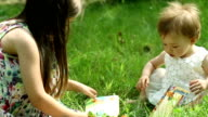 Two little girls reading books in the garden video