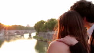 two lovers admire the sunset, with the background of St Peter - sunshine video