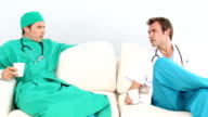 Two male doctors in a staff room video