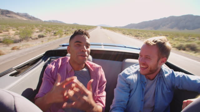 Two Male Friends On Road Trip In Convertible Car Shot On R3D video