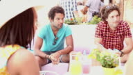 Two male friends sitting on terrace cafe in summer video
