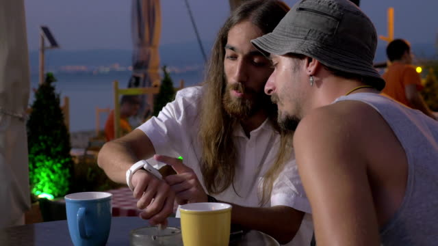Two man are speaking about smart watch and reseaching it Thessaloniki, Greece video