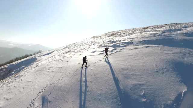 Two man climbing on mountain covered with snow video