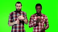 Two man drinks cola soda video