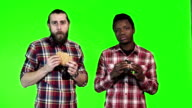 Two man eating burgers video