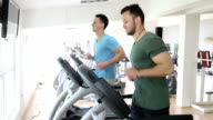 two man exercising in gym video