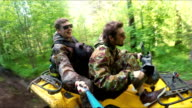 Two Man on ATV in forest video Selfe video