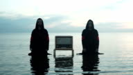Two Mans With Radioreceiver In The Sea video