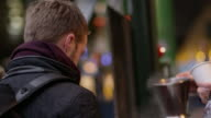 Two Men Buying Mulled Wine At Christmas Market Shot On R3D video
