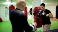 Two men having boxing workout indoors video