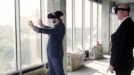 Two men in oculus rift discussing window design video