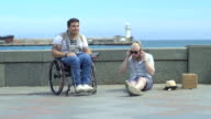 Two Men Listen To Music On The Embankment video