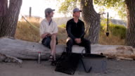 Two men quietly camping in nature video