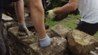 Two Men Repairing Dry Stone Wall video