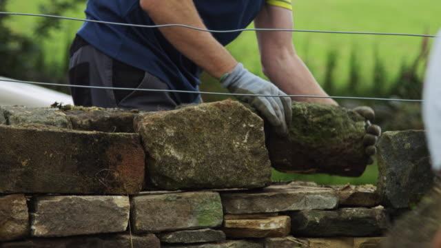Two Men Repairing Wall video