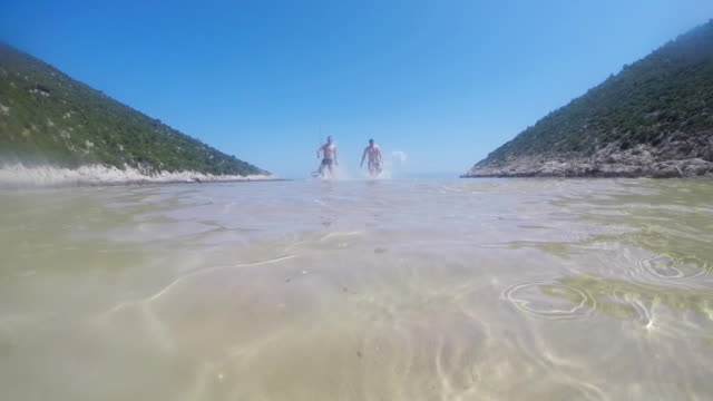 Two Men Running In Shallow Water video