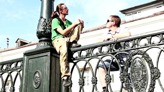 Two men talking video