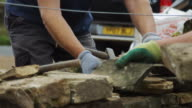 Two Men Working on Dry Stone Wall video