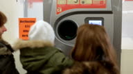 Two mother and baby girl recycling bottles at the supermarket video