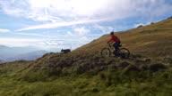 Two mountain bike riders approaching a viewpoint video