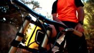 Two mountain biker fist bumping video