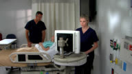 Two nurses serve female patient in bright room video