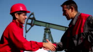 Two Oil and Gas Engineers Shaking Hands video