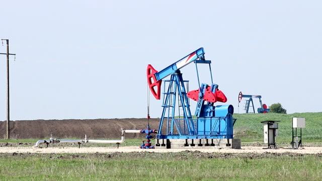 two oil pump jack on field video