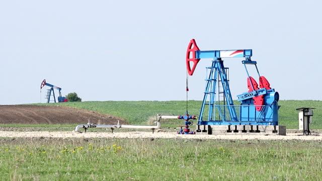 two oil pump jack on oilfield video
