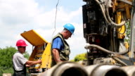 Two Oil Workers Working on Drilling Rig video