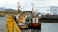 two old and rusty fishing boats is moored in harbour of Grindavik, Iceland video
