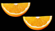 Two parts oranges on the black background. video