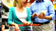 Two people buying food in supermarket. video